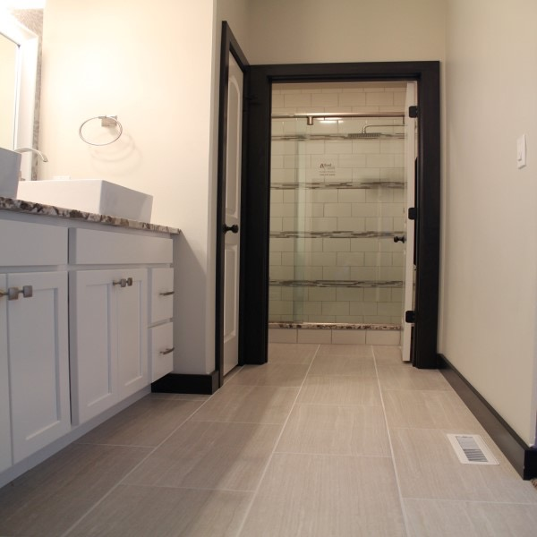 Recent bathroom floor installtion project with white grey tile